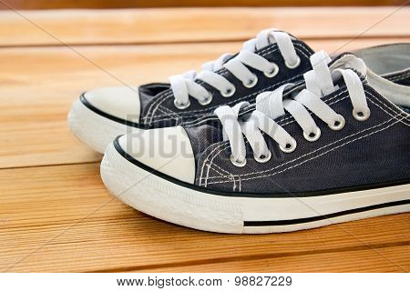 Pair Of Sneakers On The Wooden Floor