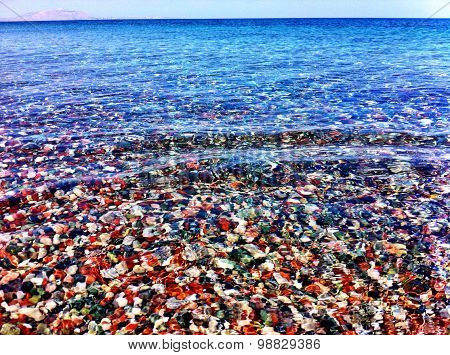 Crystal Ocean Waters Background With Multicoloured Pebbles