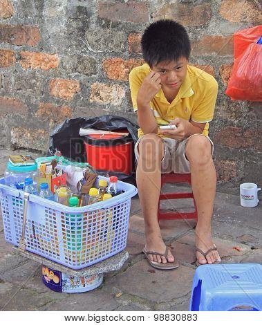 boy sells beverages, Hanoi, Vietnam
