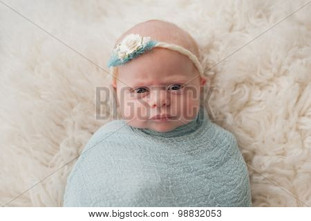 Swaddled Baby Girl With Cute Expression