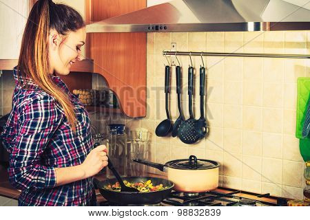 Woman Frying Frozen Vegetables. Stir Fry.