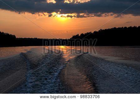 Boat Wake At Sunset