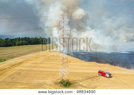 Fireman Truck Working On The Field On Fire