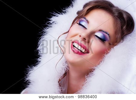 beautiful woman with makeup against black background, Christmas topic