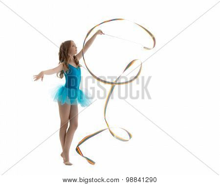 Adorable little girl dancing with ribbon