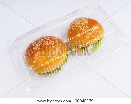 Plastic Take Away Package With Small Hamburgers Inside