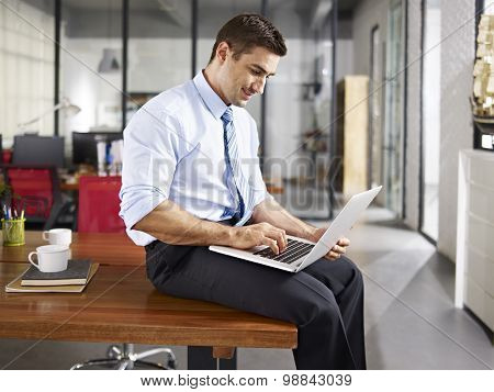 Caucasian Businessman Working In Office