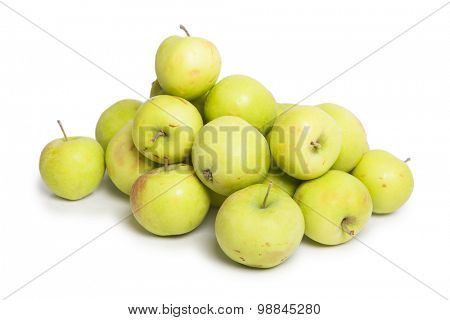 Many green apples isolated on white background