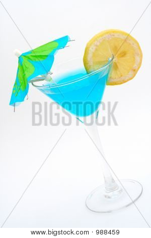 Blue Cocktail With Lemon And Umbrella