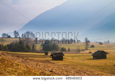 Rural mountain landscape with a hut