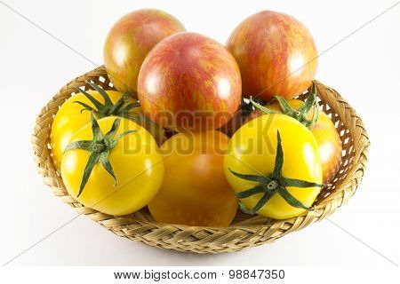 Red And Yellow Tomatoes In Wicker Oval Shape
