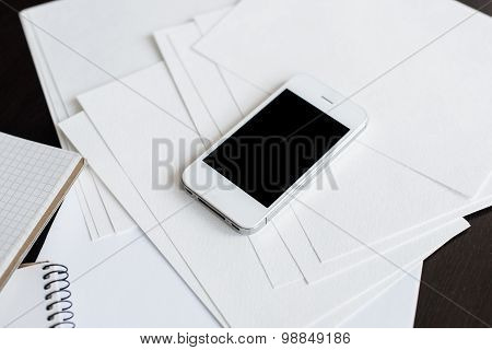 Smartphone and clean white paper