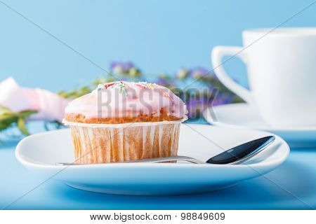 Colorful Muffin On Saucer With Flowers