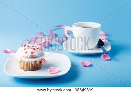 Colorful Muffin On Saucer With Flower Petal And Ribbon