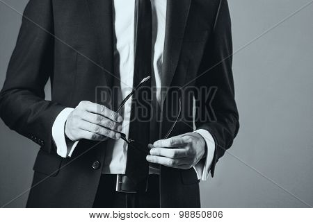 man in suit on a grey background, black and white  toning