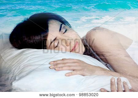 double exposure  sleeping girl and blue ocean, dreams of the sea