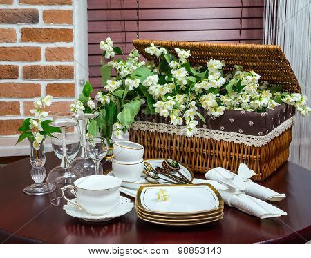 Tableware And Jasmine Flowers In The Interior