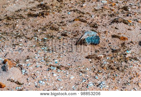 Sand and small coastal rocks on the beach