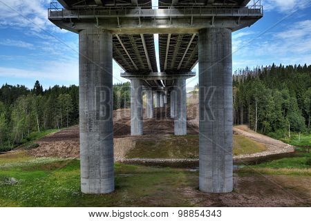 Unfinished Steel Road Bridge On Concrete Pillars, Crosses Bed Stream.