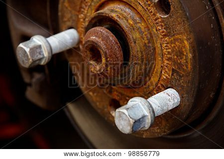rusty brake disk and detail of the wheel hub
