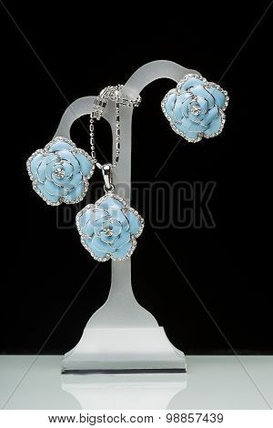 earrings with blue stones on the black. flowers