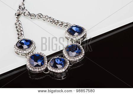 Bracelet with blue stones over black