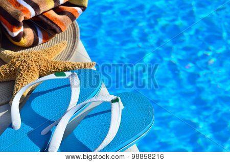 Woman Beach Hat, Bright Towel And Blue Flip-flops