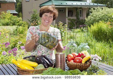 Happy Woman Making Home Made Pickles