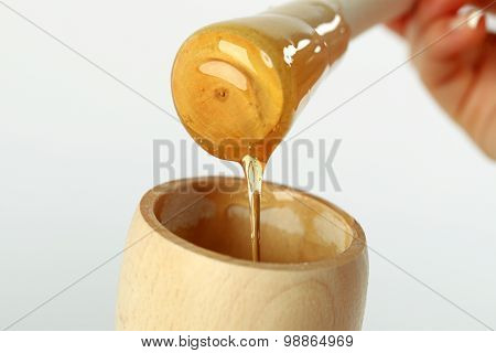 Honey Dipper On The Bee Honeycomb Background. Honey Tidbit In Glass Jar And Honeycombs Wax.
