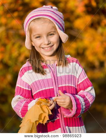 smiling  girl  against the leaves of mountain ash