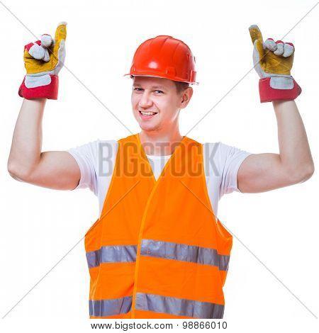 handsome worker man in a helmet on white