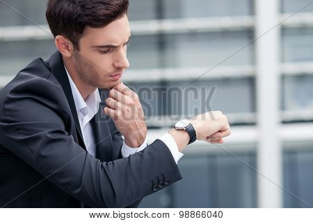 Cheerful young man is waiting for his business partner