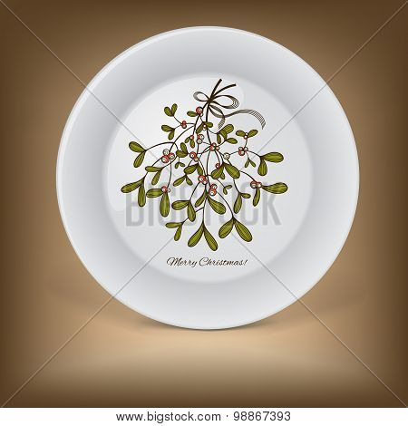 Christmas decorative plate with branch of mistletoe