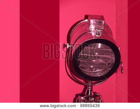 Chrome Stage Light On Red Background.
