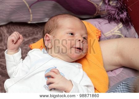 Smiling Newborn On A Blanket
