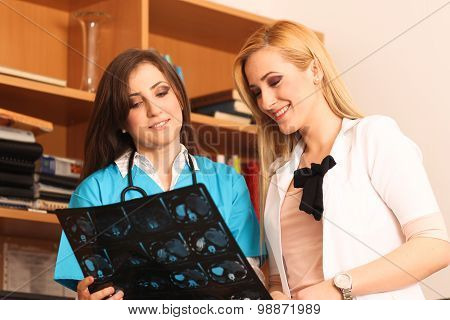 Two Beautiful Female Doctors Smiling At Work