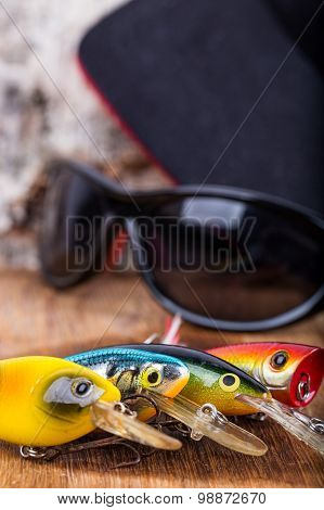 Closeup Fishing Baits Wobblers With Sunglass