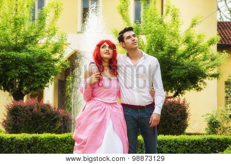 Romantic Fairy Tale Couple Embracing in Beautiful Palace Garden