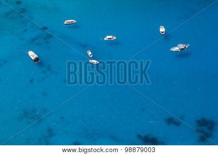 Boats Anchored In A Sea Bay