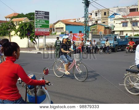 Cambodia, Phnom Penh - CIRCA APRIL 2014. Cyclists on the streets of Phnom Penh