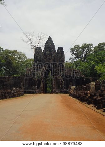 a bridge with an arch in the Holy city of Angkor