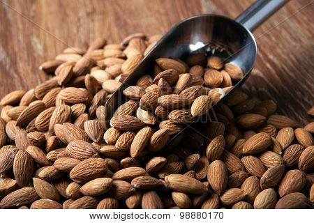 Handful Of Almonds And Scoop
