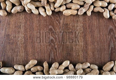 Peanuts On The Wooden Background