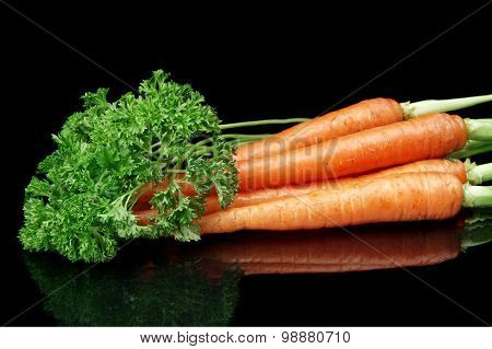 Fresh Carrots With Parsley Leaves Isolated On Black Background