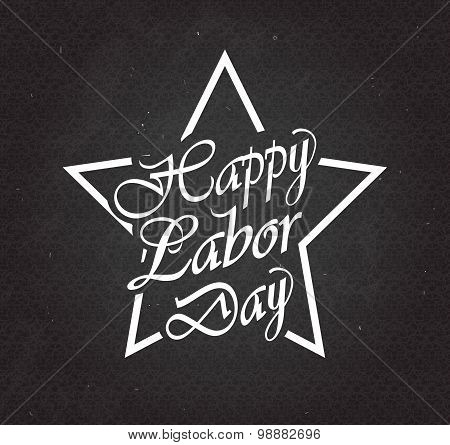 Happy Labor Day text in star on black chalkboard