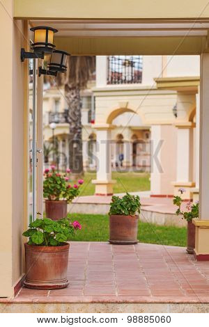 Porch rustic Villa in Tuscan style with flowers, ceramic pots