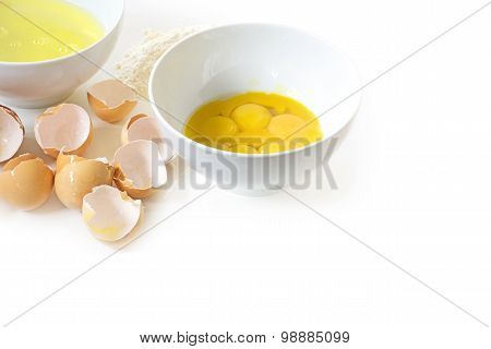 Separate The Eggs For Baking, Egg Yolk And Egg White In Bowls, Eggshells And Some Flour Isolated On