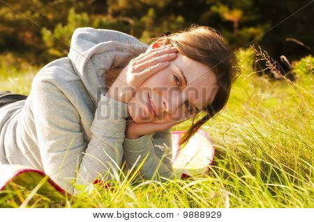 Pretty Young Woman Lying In Green Gras