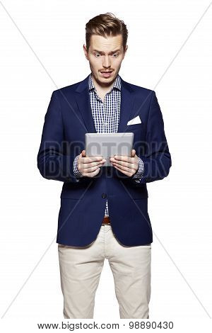 Worried Man Using Digital Tablet