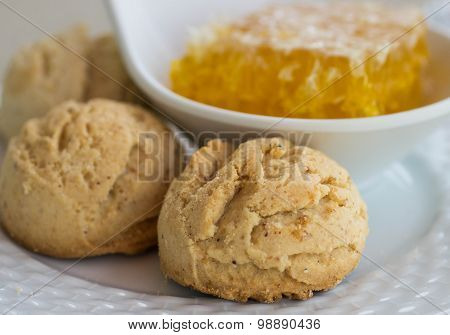 Traditional round shortbread biscuits with honey. Selective focus